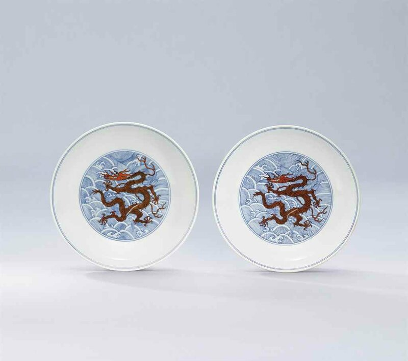 Two iron-red and underglaze-blue decorated 'dragon' dishes, Qianlong six-character seal marks in underglaze blue and of the period (1736-1795)