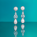 A superb pair of natural pearl and diamond ear pendants