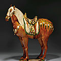 An important massive sancai-glazed pottery figure of a Fereghan horse, Tang dynasty (618-907)