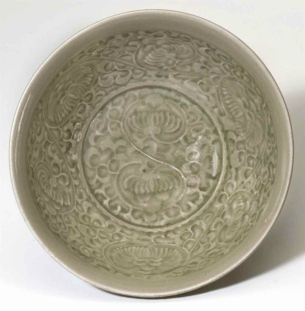 A molded Yaozhou deep bowl, Northern Song dynasty, 11th-12th century