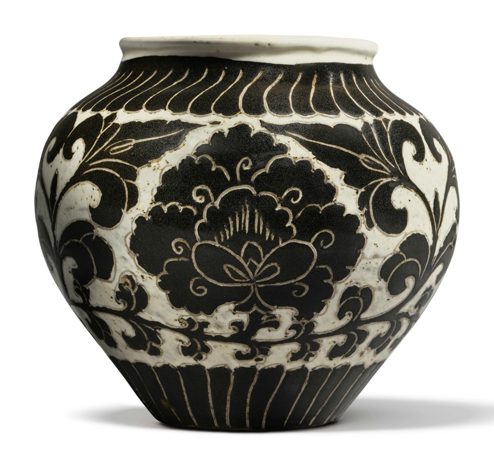 A small and rare 'Cizhou' sgraffiato 'peony' jar, Northern Song dynasty (960–1127)