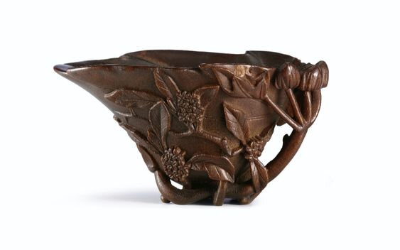 A rhinoceros horn 'Hollyhock and Crab Apple' libation cup, Qing Dynasty, 17th-18th century