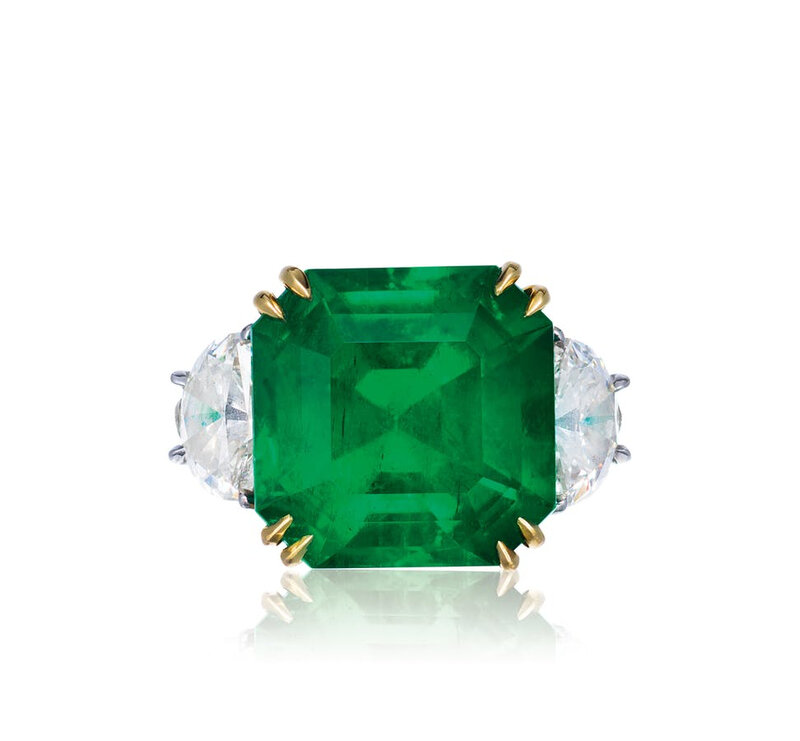 A 9.33 carat no oil Colombian emerald and diamond ring